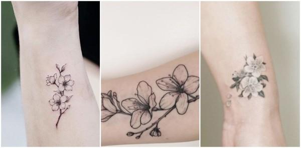 tatuagem flor de cerejeira preta e branca
