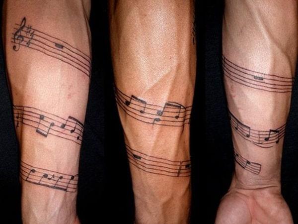 tatuagem de música em todo o braço