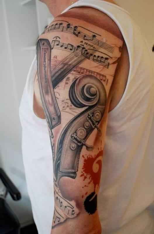 tatuagem de música no braço grande