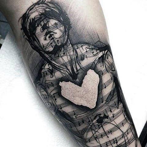 tatuagem de música no braço
