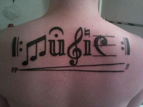 tatuagem de símbolo de música conceitual
