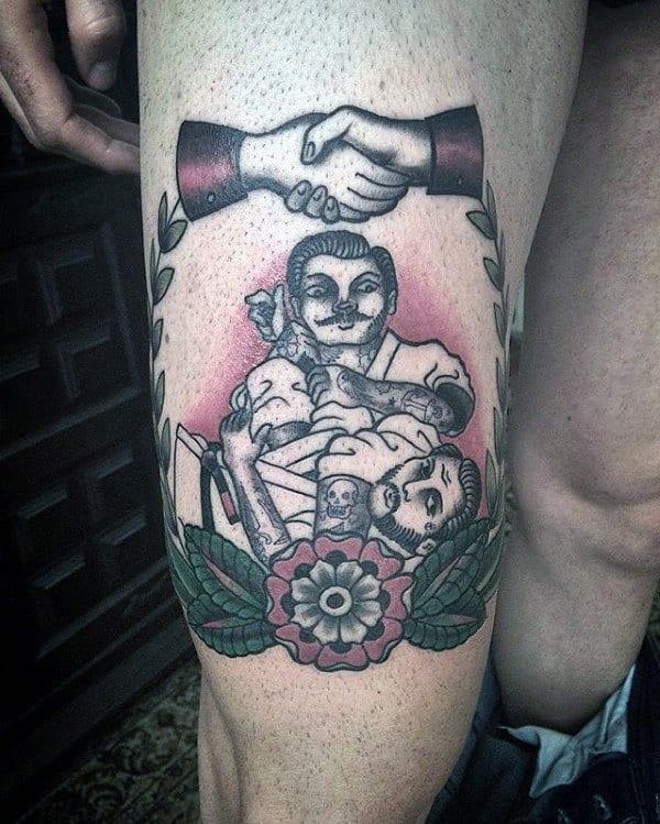 tatuagem jiu jitsu na perna
