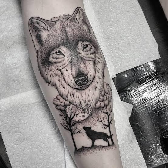 tatuagem na panturrilha masculina lobo grande