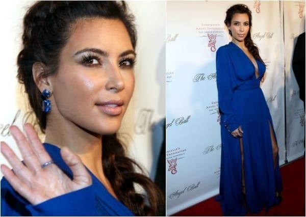 Famosa com vestido azul e make