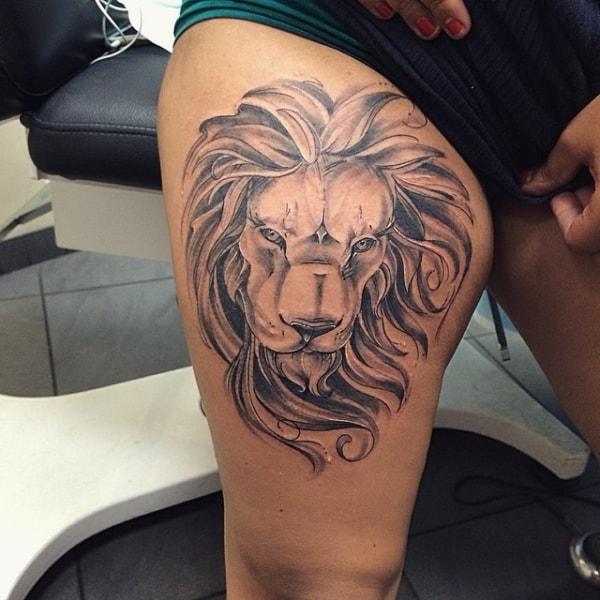 tatuagem na coxa masculina leão grande