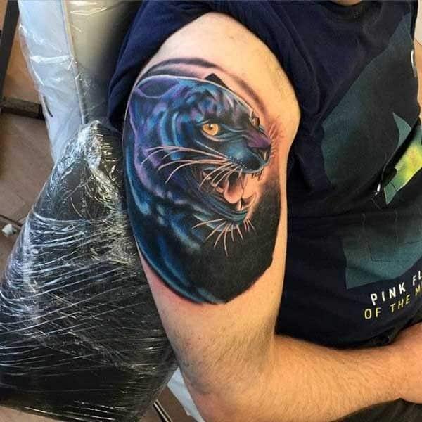 tatuagem pantera negra no braço