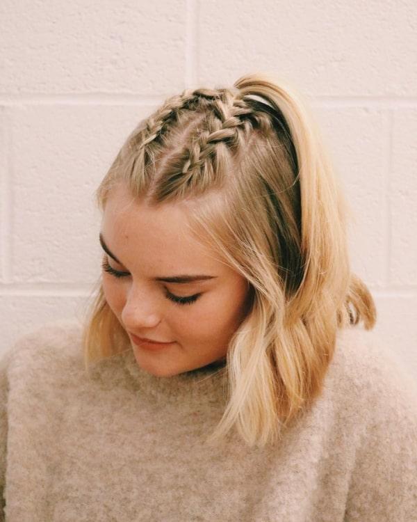 cabelo preso para trás com tranças embutidas