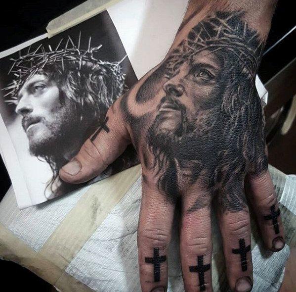 Tatuagem Jesus Cristo na mão