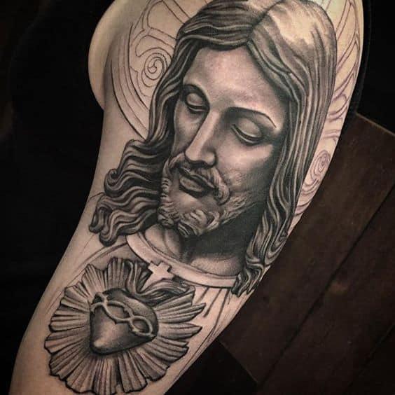 Tatuagem Jesus Cristo no braço clássica