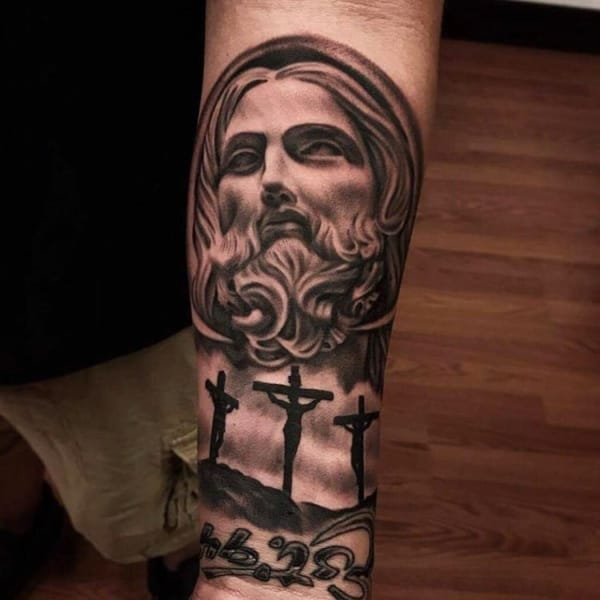 Tatuagem Jesus Cristo no braço