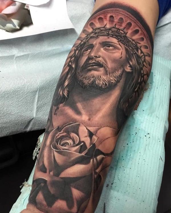 ideia de Tatuagem Jesus Cristo na perna
