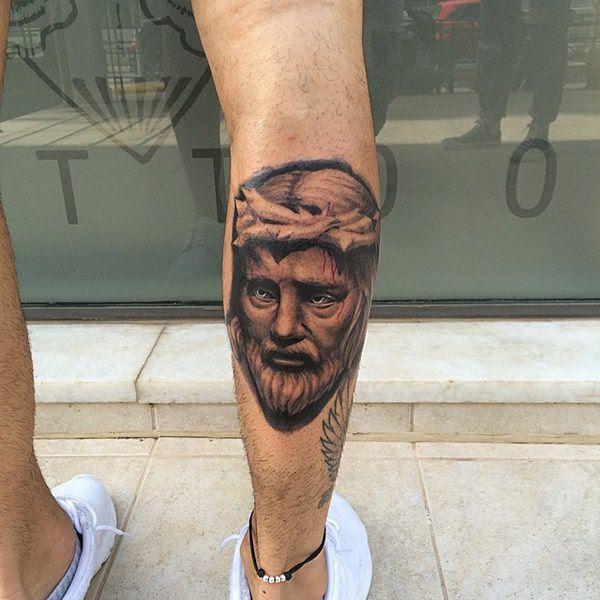 rosto de Jesus na perna