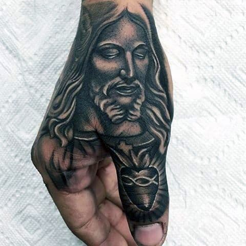 tattoo de Jesus na mão