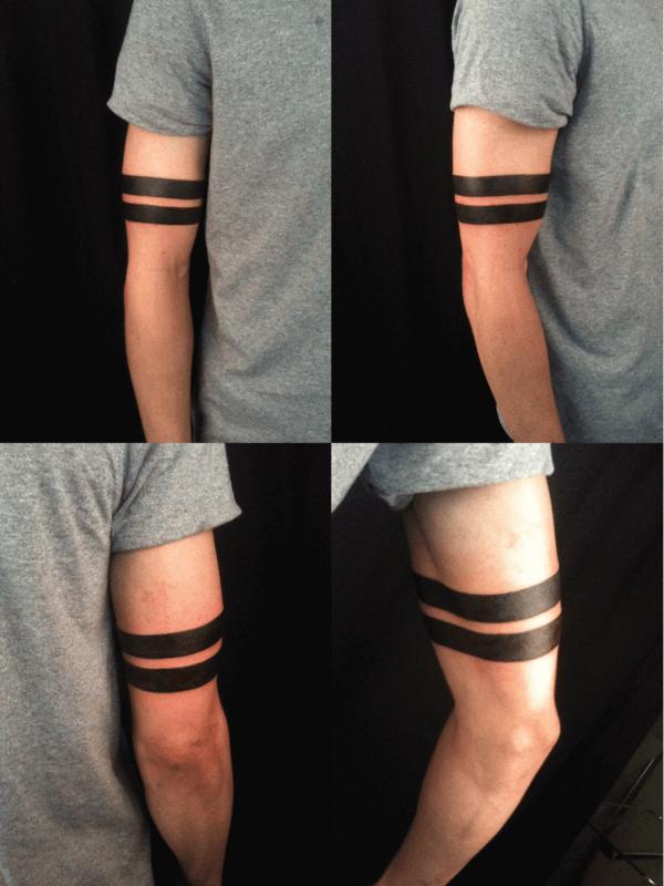 tatuagem no bíceps masculino bracelete simples