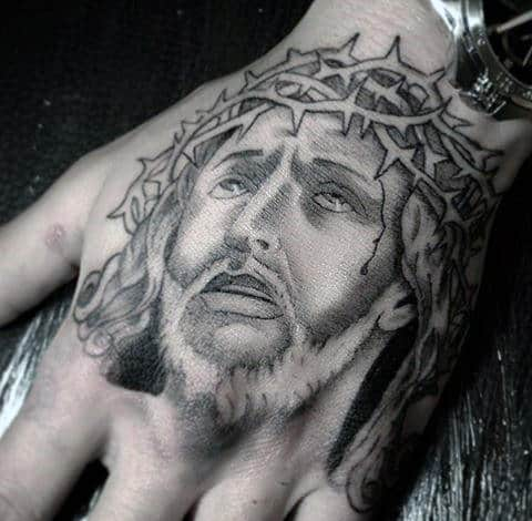 tatuagem simples na mão de Jesus