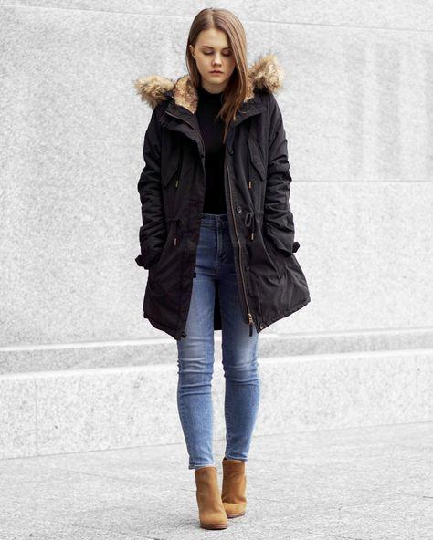 look de inverno com calça jeans e casaco preto
