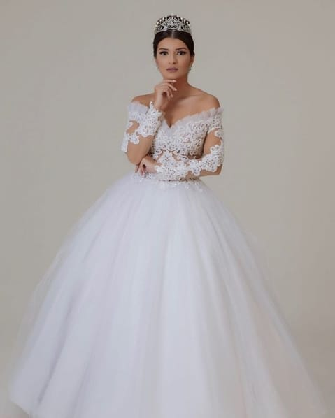 vestido de noiva rodado com saia de tule e mangas longas