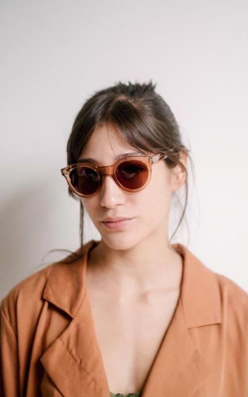 óculos de sol feminino redondo com armação grossa