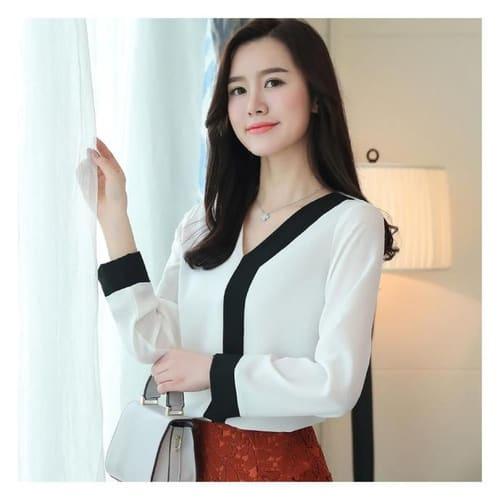 Camisa de manga longa branca e preta