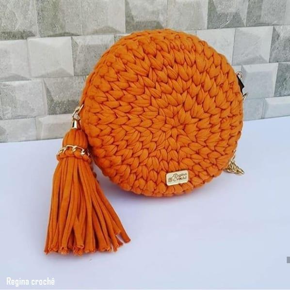 bolsa laranja e redonda em fio de malha