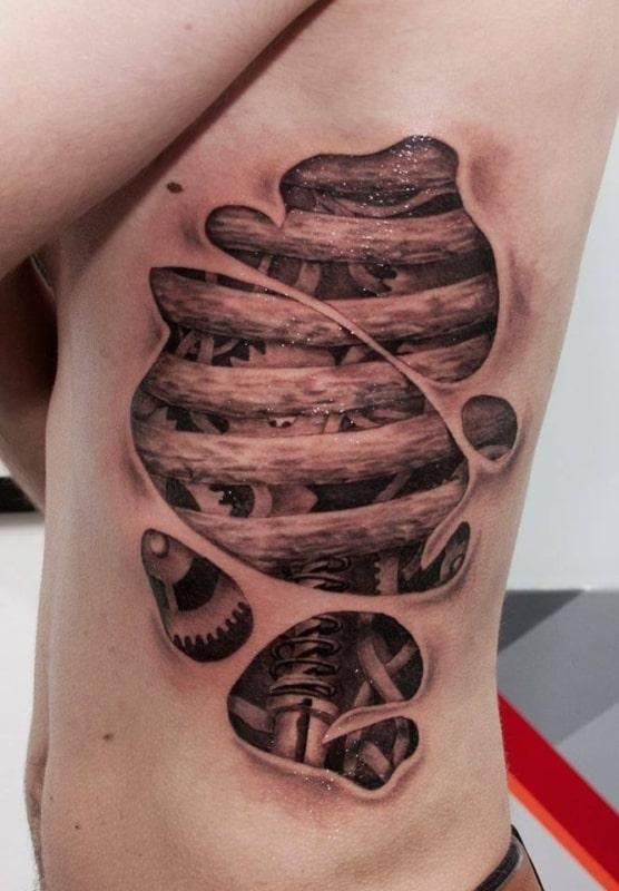 tatuagem de amortecedor na costela