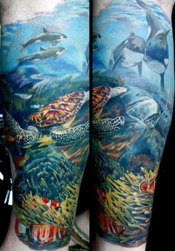 tatuagem fundo do mar na perna enorme