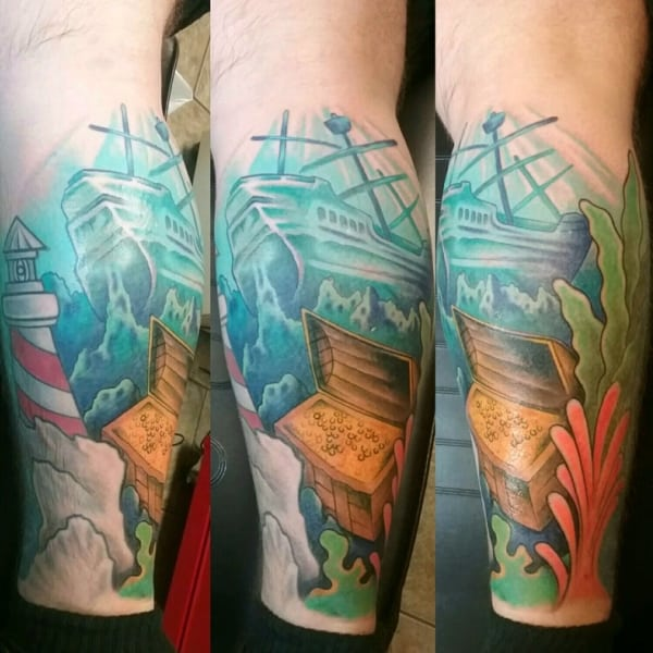 tatuagem fundo do mar na perna
