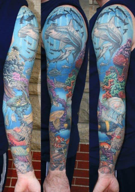 tatuagem fundo do mar no braço grande
