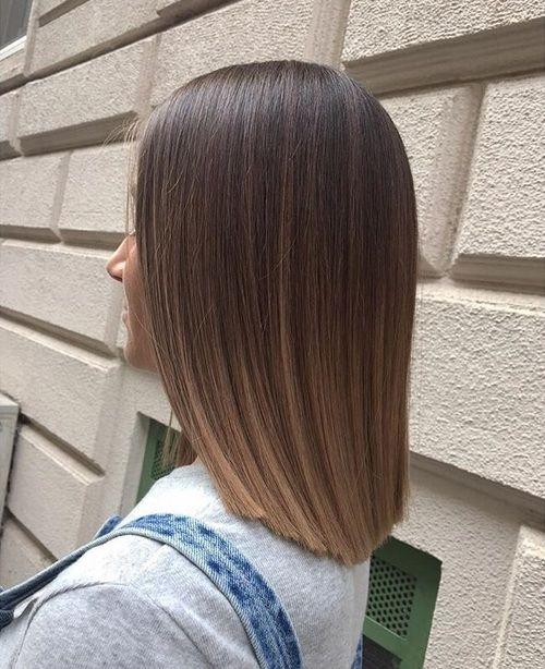 Castanho iluminado em cabelo e medio