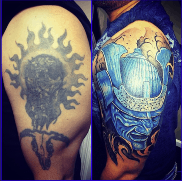 cobertura de tatuagem no braço grande
