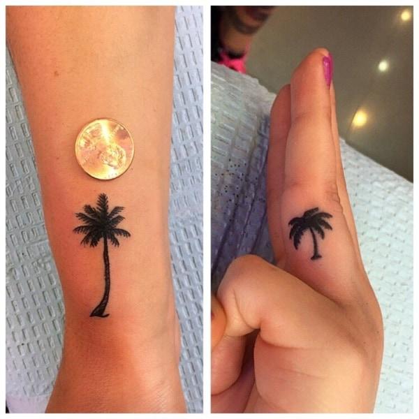 tatuagem de coqueiro na mão