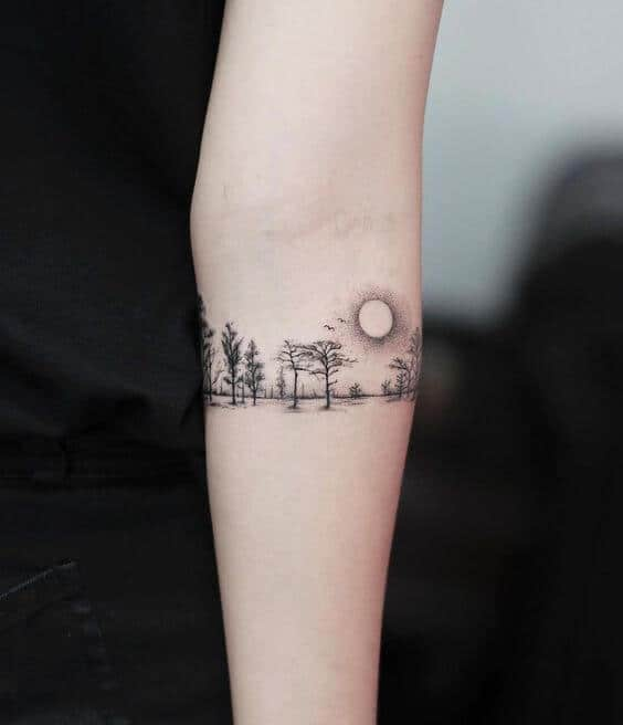 tatuagem de natureza delicada e estilo bracelete