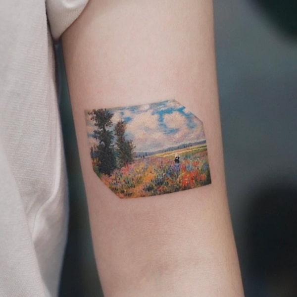 tatuagem feminina colorida de natureza no braco