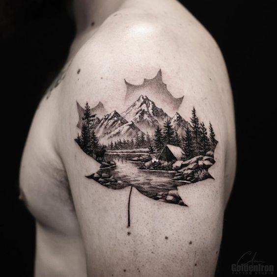 tatuagem de natureza no braco com folha