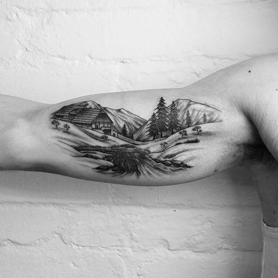 tatuagem no braco de natureza com cabana