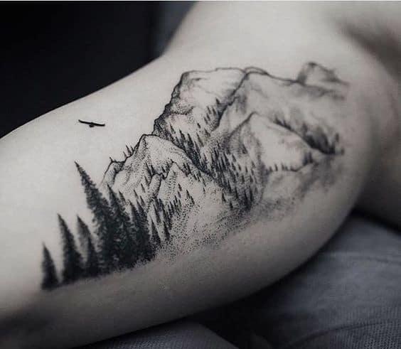 tatuagem masculina de arvores no braco