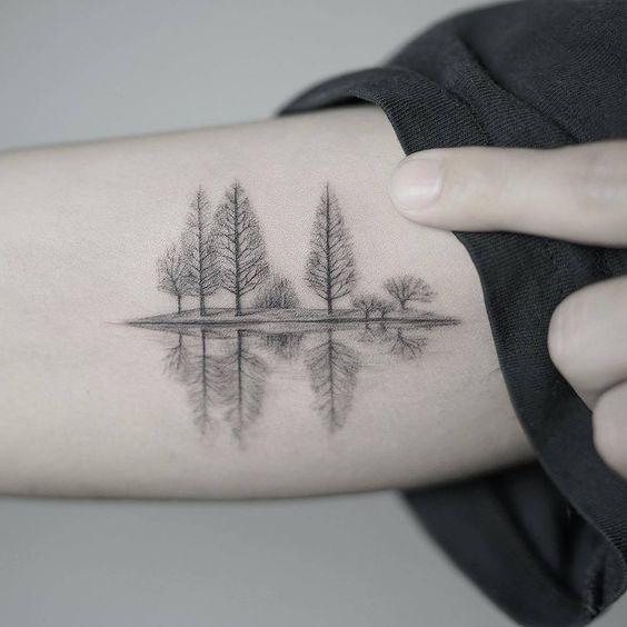 tatuagem delicada de natureza no braco