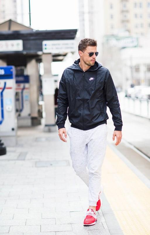 look masculino com corta vento preta da Nike