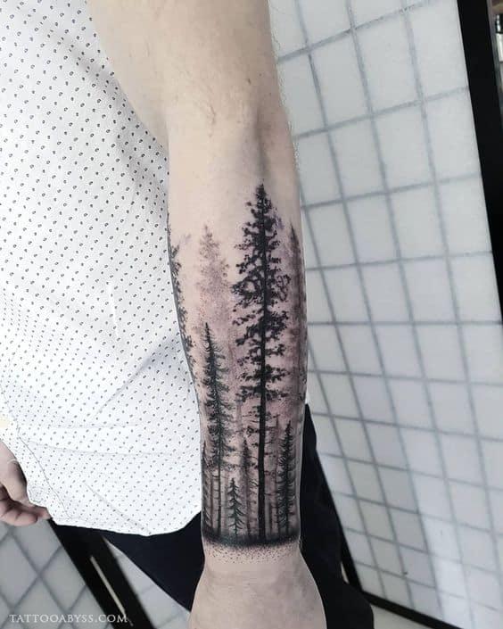 tatuagem floresta negra no antebraco