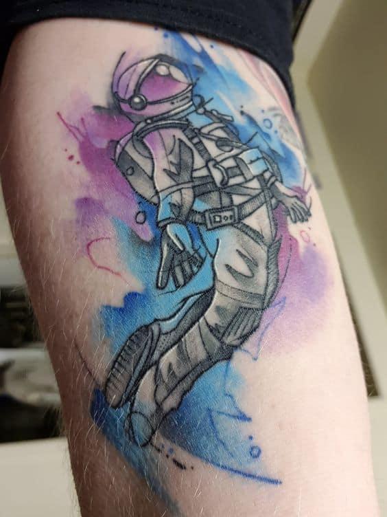 tattoo aquarela de astronauta
