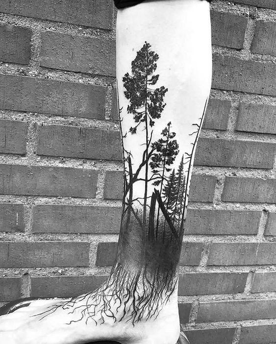 tattoo de floresta negra na perna
