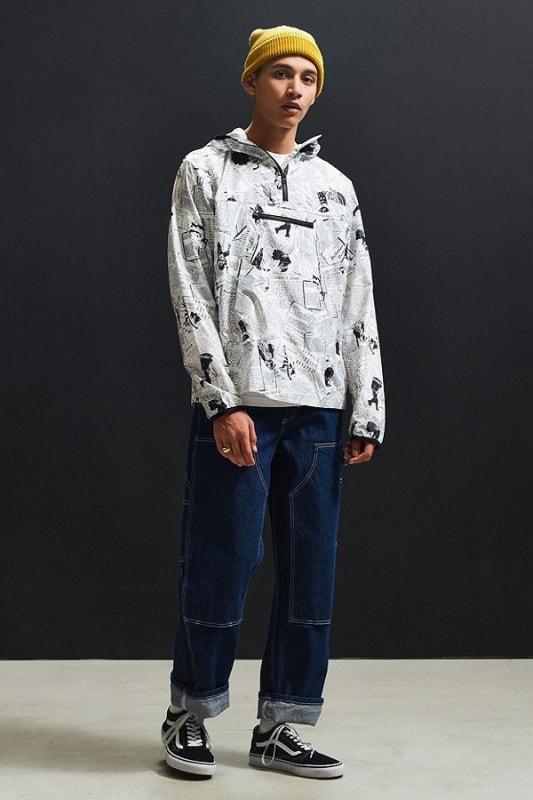 look masculino descolado com jeans e corta vento estampada