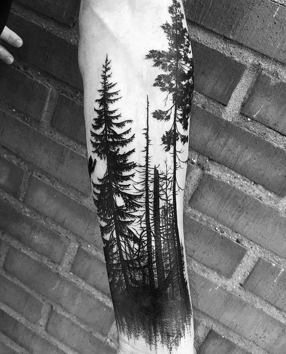 tatuagem grande de floresta negra no braco